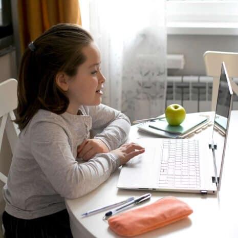 Pretty girl studying at home. Home school, online home education, quarantine, coronavirus concept